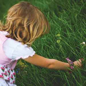 Girl Picking Spring Flowers